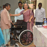 Donor&welwisher  of GOODWILL HANDS is distributing wheelchair to needy crippled leper during visit