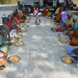 Serving of special food chicken briyani during welfare needs distribution camp